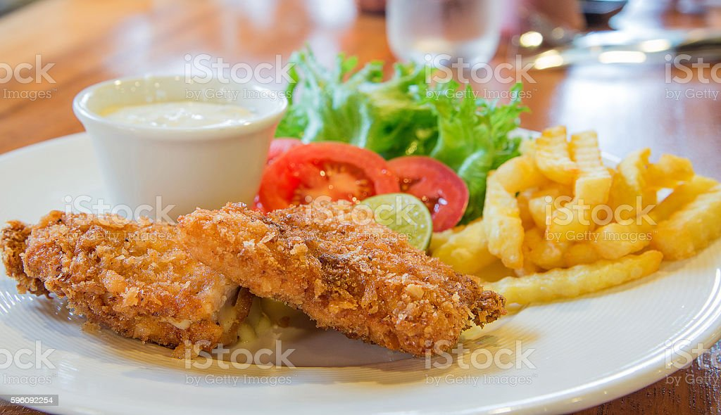 Chicken nuggets,French Fries,Vegetables  on wooden table. royalty-free stock photo