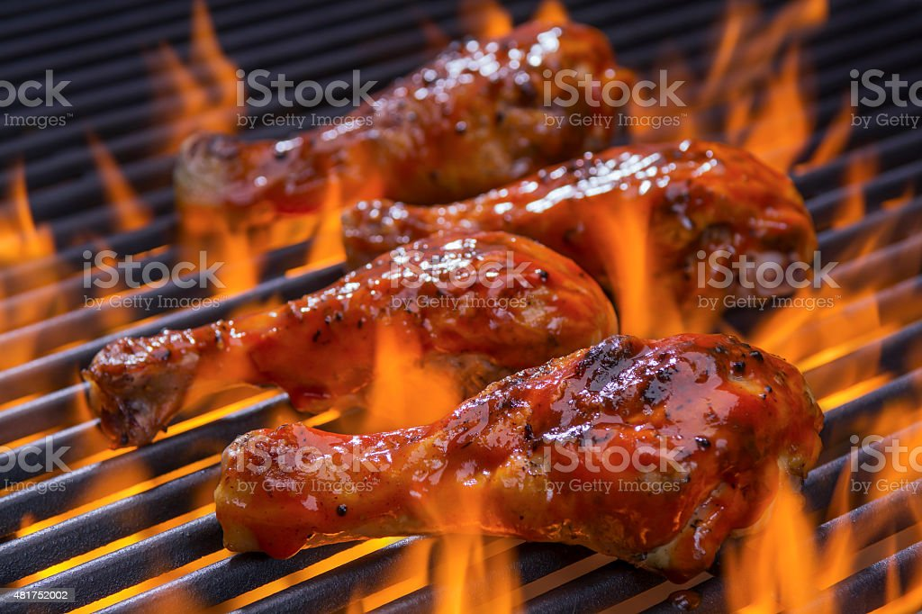Chicken on a hot flaming Barbecue stock photo