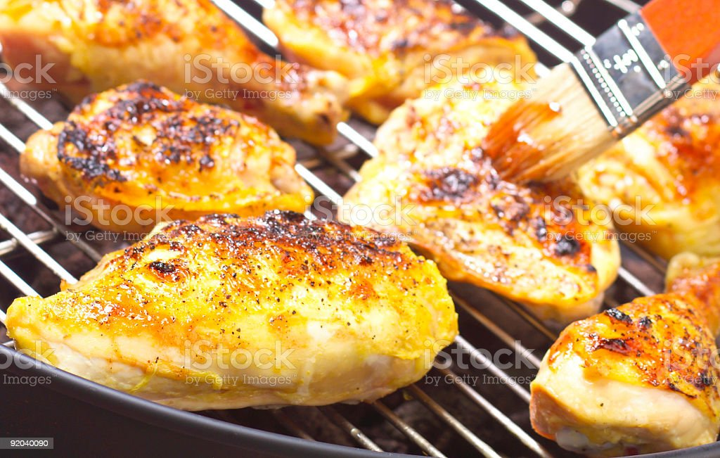 BBQ chicken on grill with selective focus stock photo