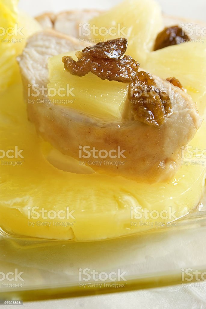 chicken on pineapple fruit with raisins royaltyfri bildbanksbilder