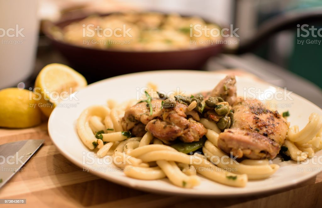 Chicken on plate with fresh pasta cooking at home stock photo