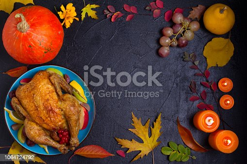 Chicken or turkey,  pumpkin, fruits, wheat and autumn leaves. Thanksgiving food concept. Harvest or Thanksgiving background. View from above, top studio shot