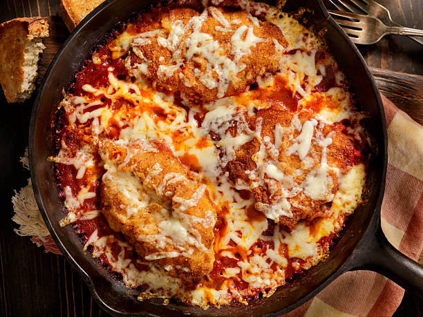 chicken parmesan baked in tomato sauce with mozzarella cheese - parmesan stock photos and pictures