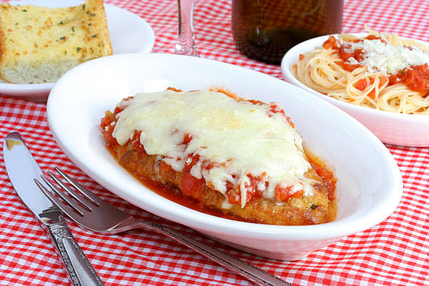 chicken parmigiana dinner - parmesan stock photos and pictures