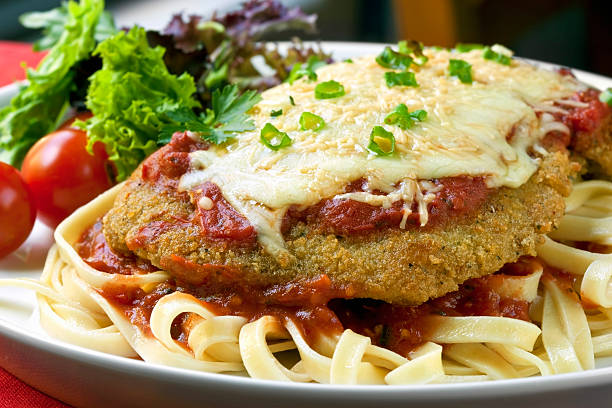 chicken parmigiana - parmesan stock photos and pictures