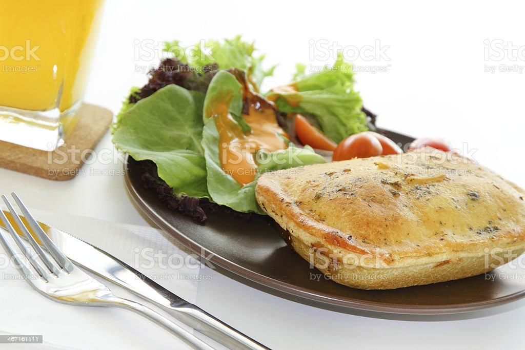 Chicken pie with salad and orange juice royalty-free stock photo