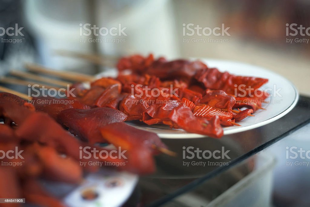 Chicken, pig ears and intestines barbeque screw, stock photo