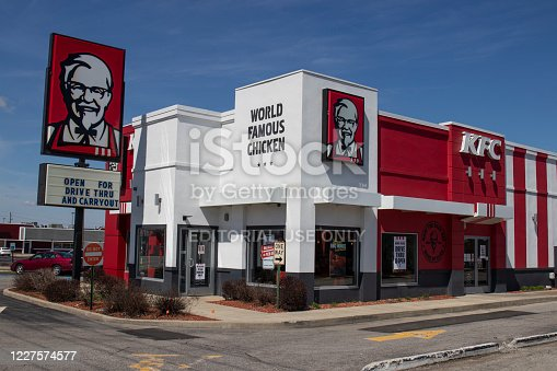 Indianapolis - Circa April 2020: KFC Chicken restaurant. Kentucky Fried Chicken is offering Uber and Door Dash delivery and drive thru service during social distancing.