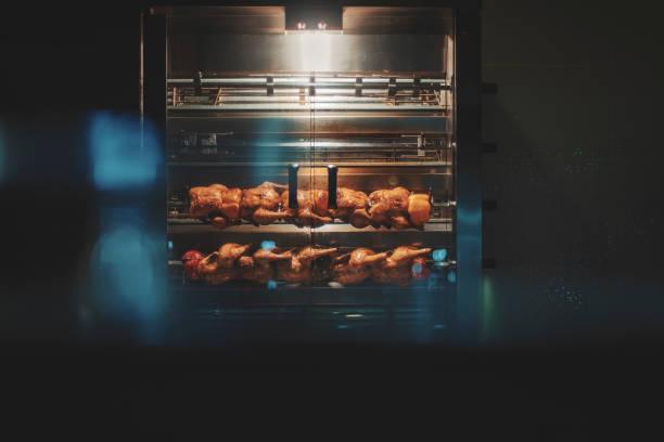chicken rotisserie oven - girarrosto foto e immagini stock