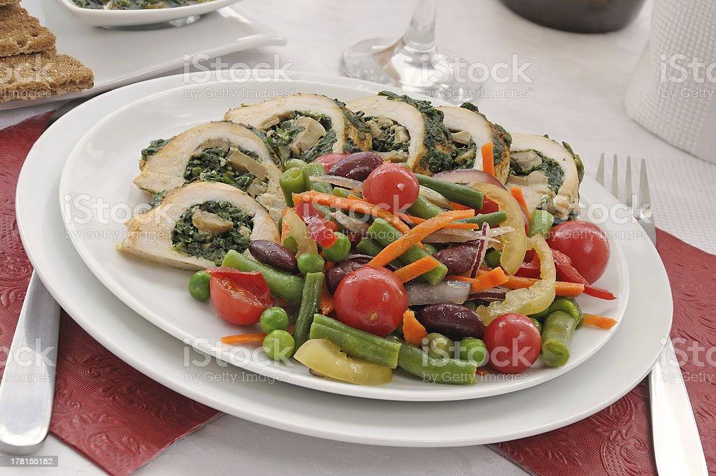 Chicken roulade with spinach and mushrooms, vegetables royalty-free stock photo