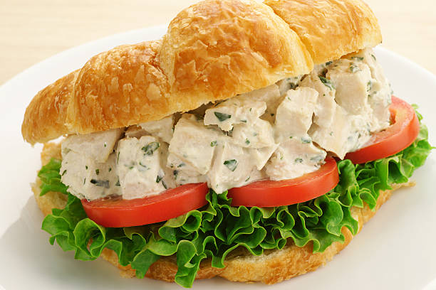 chicken salad croissant sandwich - tarragon stock photos and pictures