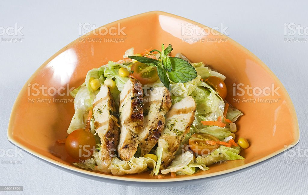Chicken salad in a triangular bowl royalty-free stock photo