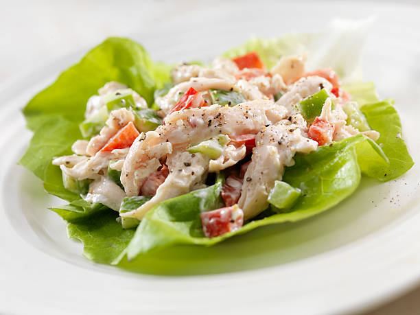 Chicken Salad Lettuce Wrap A Creamy Chicken Salad Lettuce Wrap with Red and Green Peppers- Photographed on Hasselblad H3D2-39mb Camera butterhead lettuce stock pictures, royalty-free photos & images