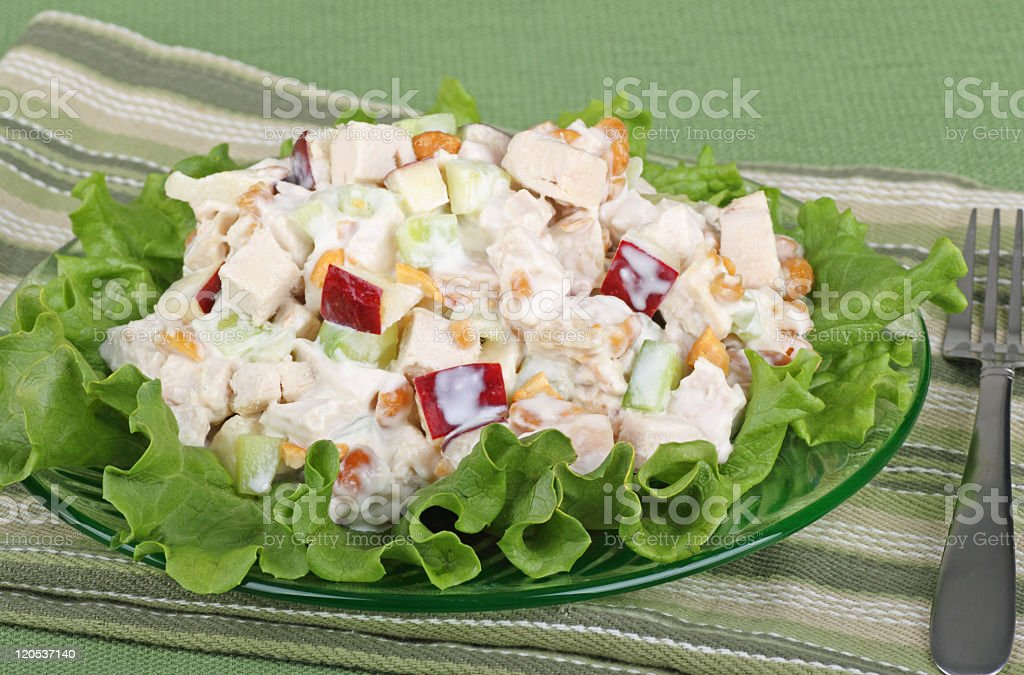 Chicken salad on a bed of greens stock photo