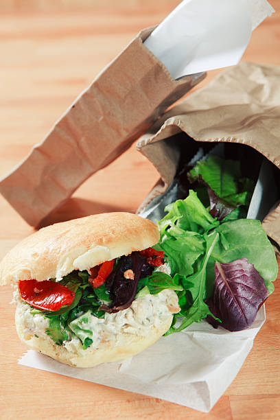 Chicken salad sandwich and brown paper bags stock photo