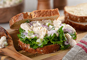 Closeup of chicken salad sandwich with lettuce on whole grain bread