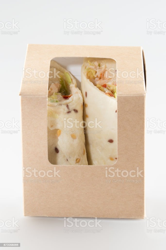 Chicken Salad Tortilla Wrap with guacamole and salad stock photo
