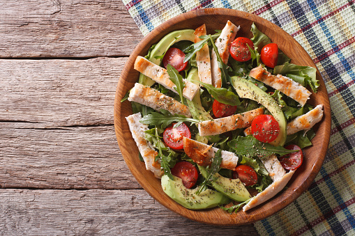 istock Chicken salad with avocado, arugula and tomatoes. horizontal 516295740