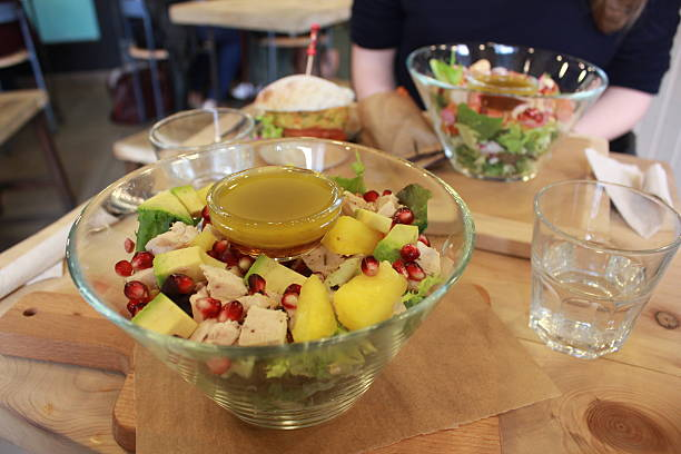 Chicken salad with avocado in glass bowl stock photo