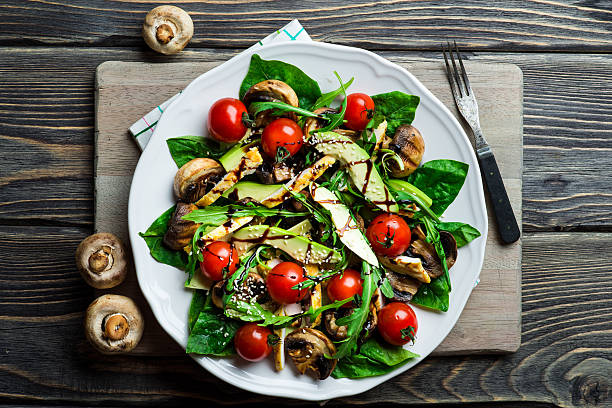 Chicken salad with avocado Chicken salad with avocado, tomatoes cherry, mushrooms and spinach main course stock pictures, royalty-free photos & images