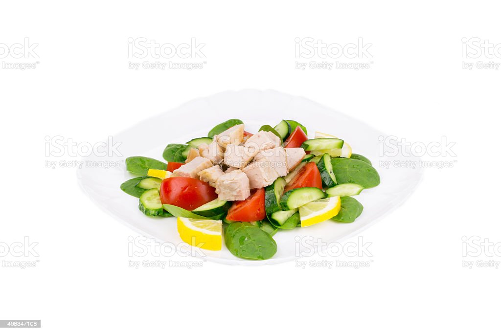Chicken salad with cucumber and tomatoes. royalty-free stock photo