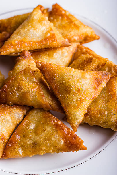 Chicken samosas deep fried. stock photo