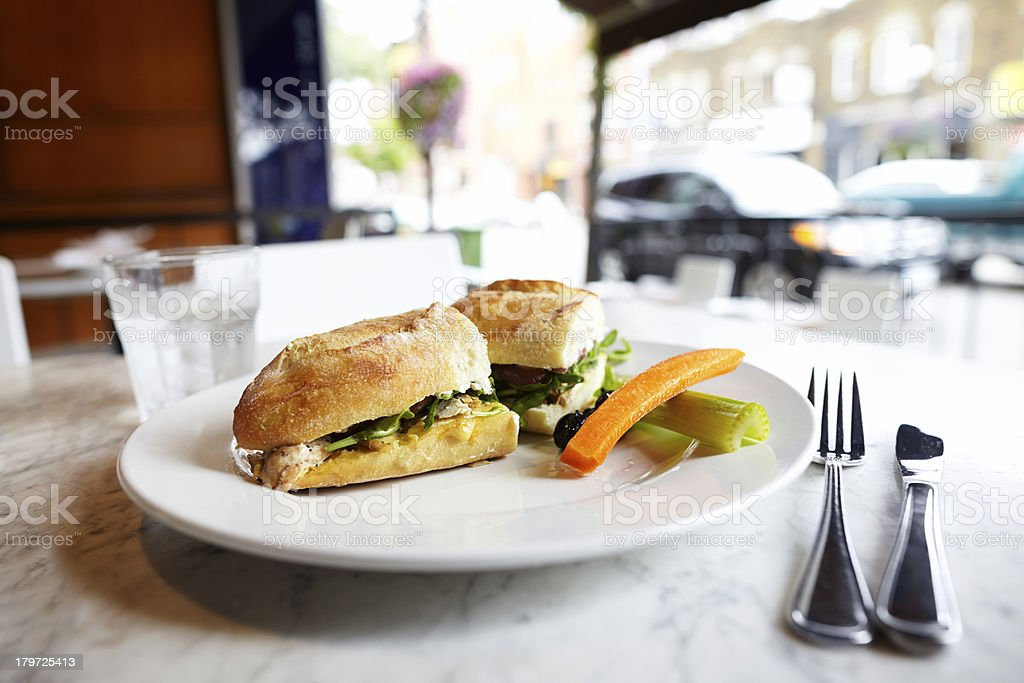 Chicken sandwich lunch on table at an outdoor restaurant royalty-free stock photo