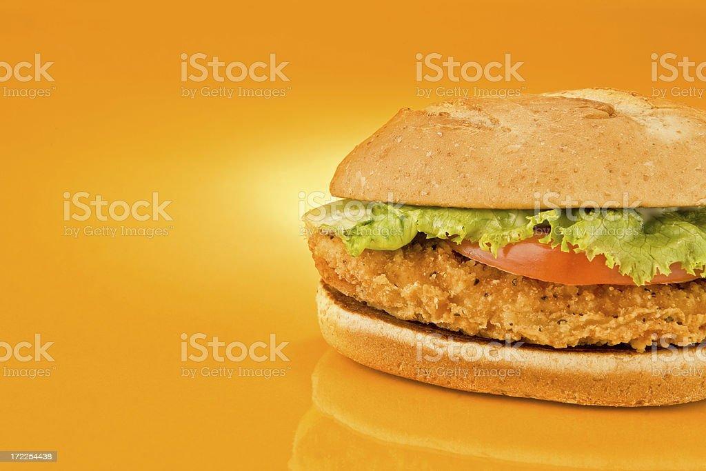 chicken sandwich on orange background (right side) stock photo