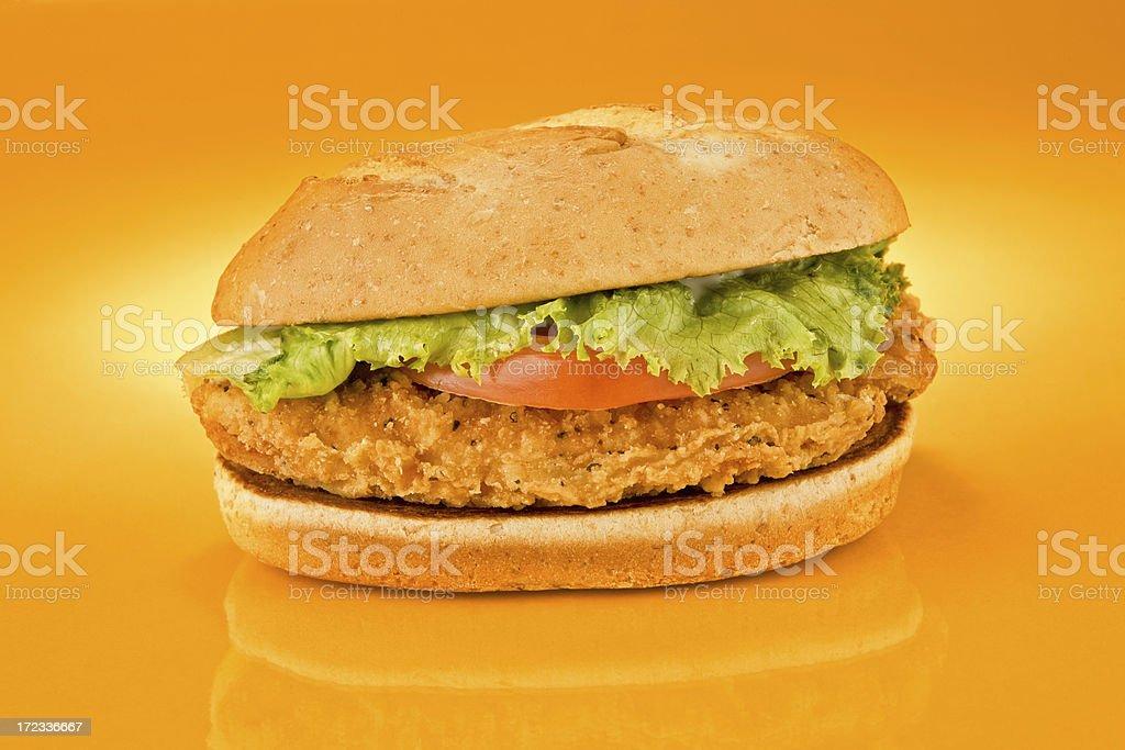 Chicken Sandwich on orange background (slant) stock photo