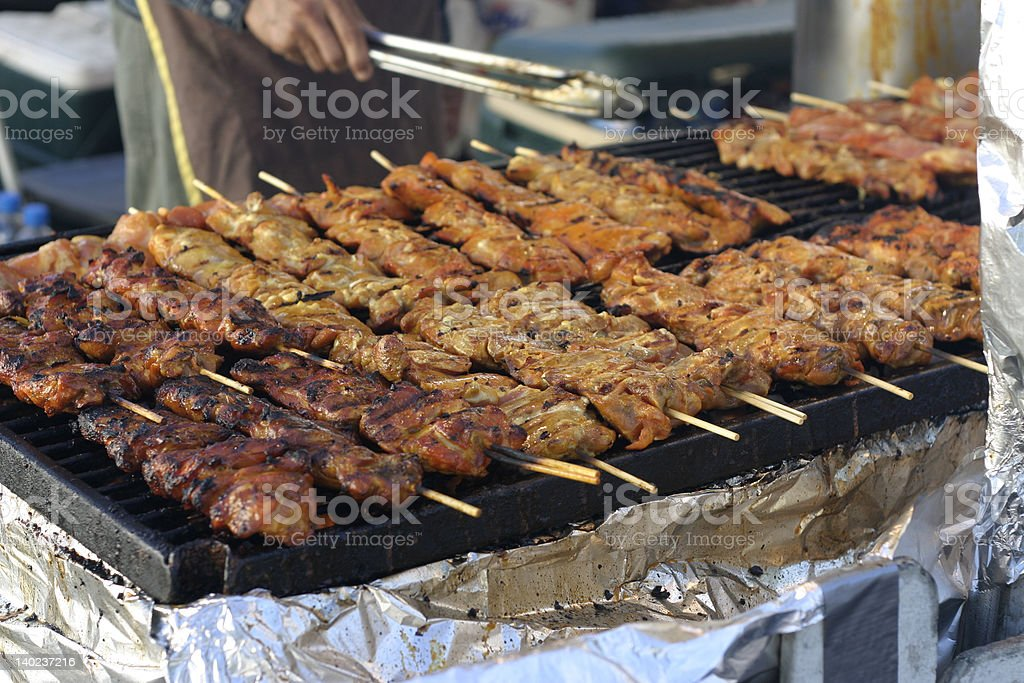 chicken satay on a grill royalty-free stock photo