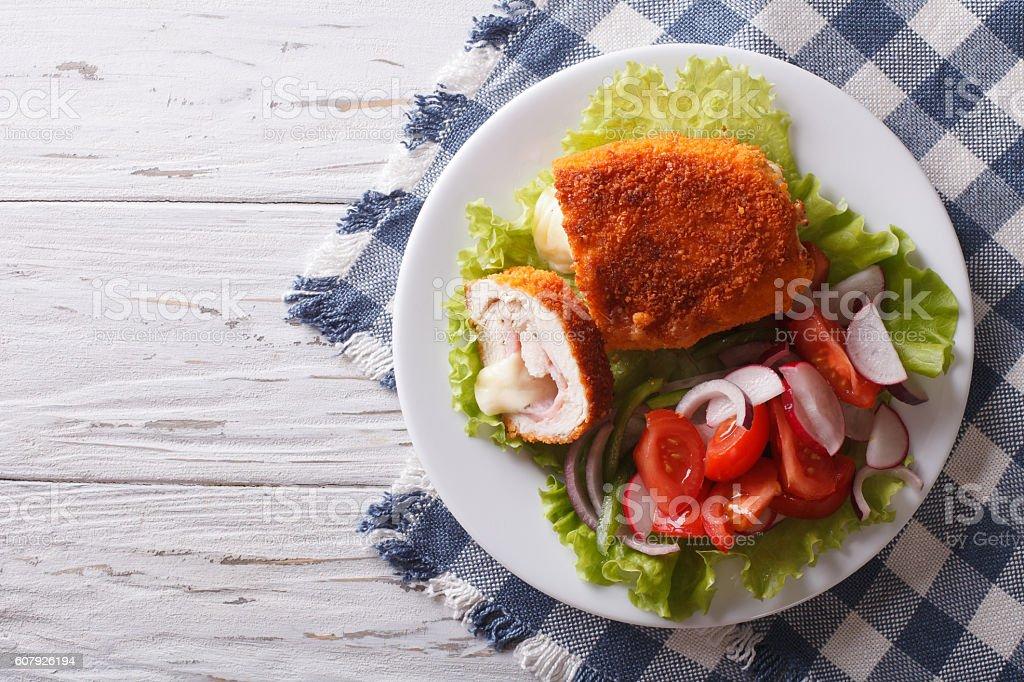 Chicken schnitzel cordon bleu and a salad. Horizontal top view – Foto