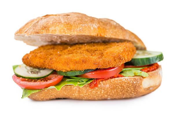 chicken schnitzel on a bun (isolated on white) - kürbisschnitzel stock-fotos und bilder