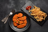 istock Chicken schnitzel or nuggets with chips and ketchup 1248418391