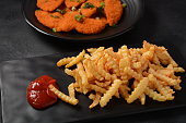istock Chicken schnitzel or nuggets with chips and ketchup 1248418496