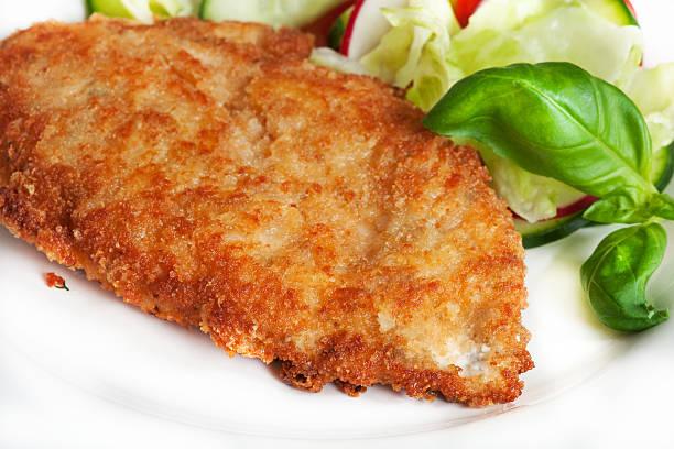 chicken schnitzel - kürbisschnitzel stock-fotos und bilder