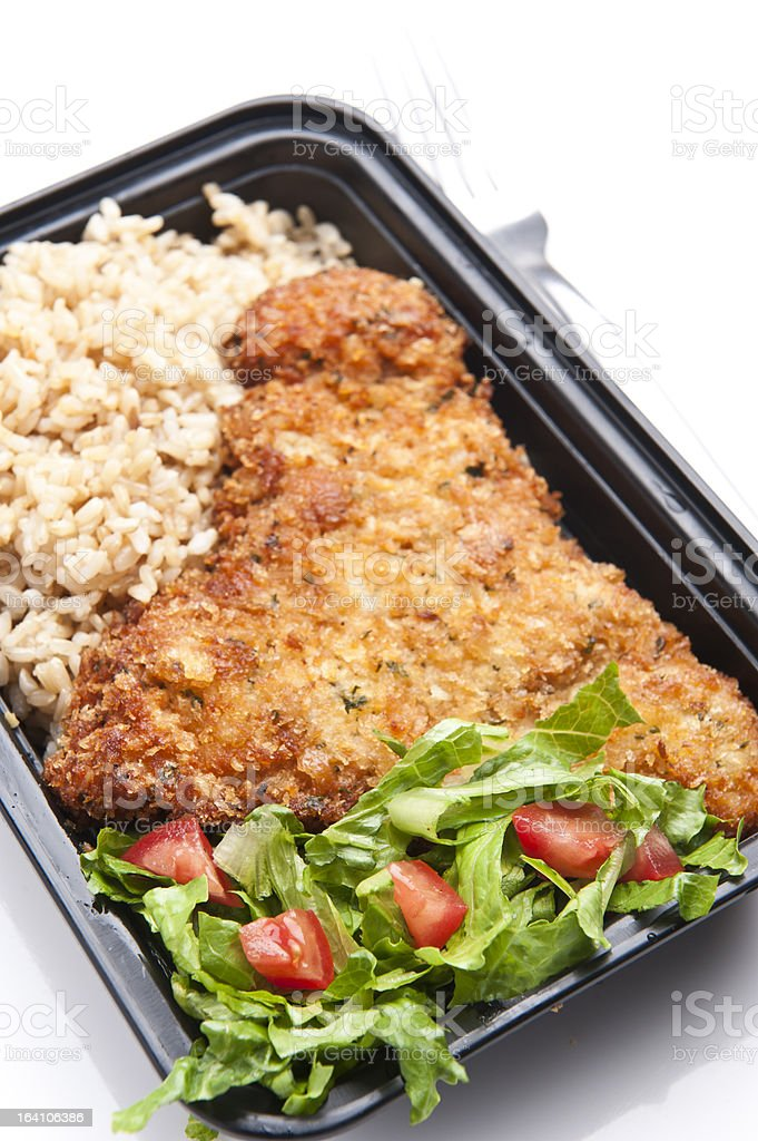 Chicken Schnitzel with brown rice and salad stock photo