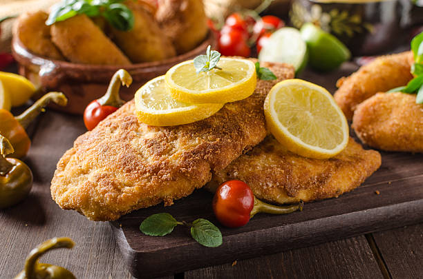 Chicken schnitzel with croquettes stock photo