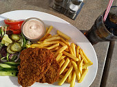 Restaurant fried chicken breast meal with Coke, gourmet fast food