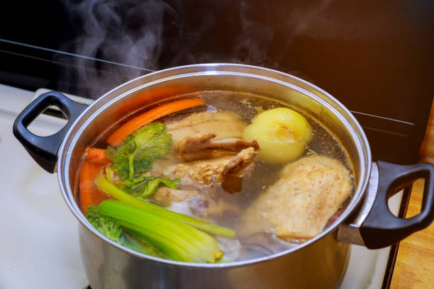 chicken soup broth ingredients carrots chicken with vegetables - caldo imagens e fotografias de stock