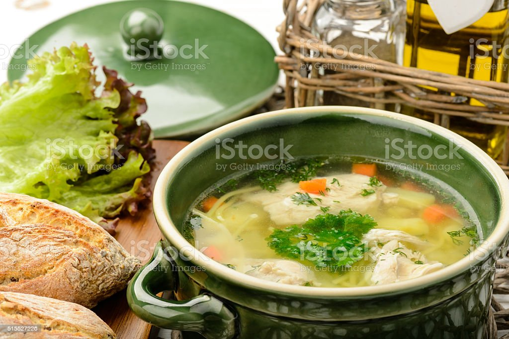 Chicken soup in ceramic bowl. stock photo