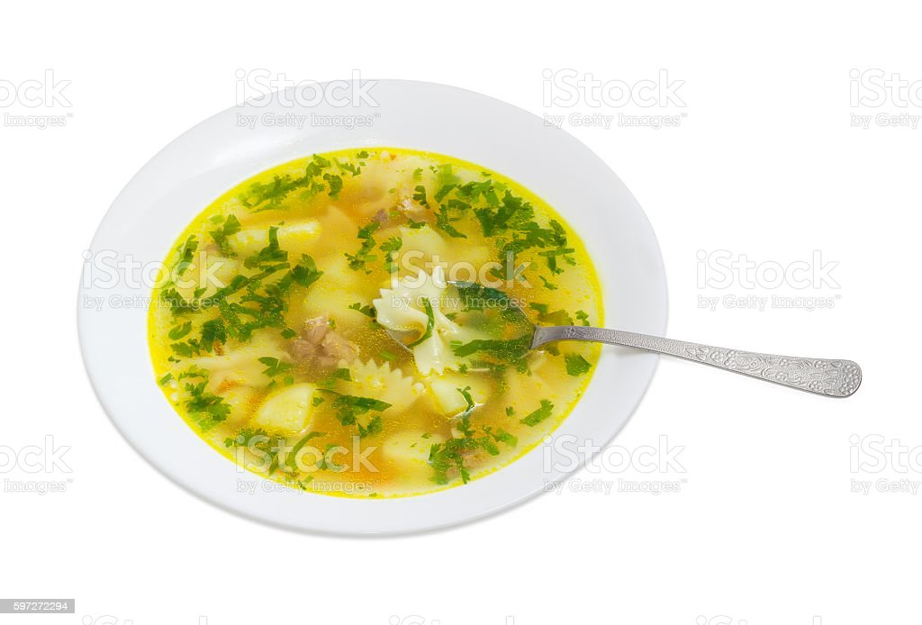 Chicken soup in white dish on a light background royalty-free stock photo
