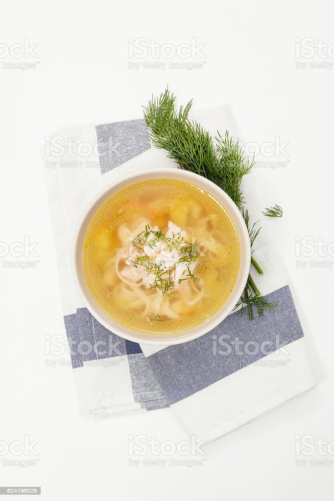 Chicken soup on white - Photo