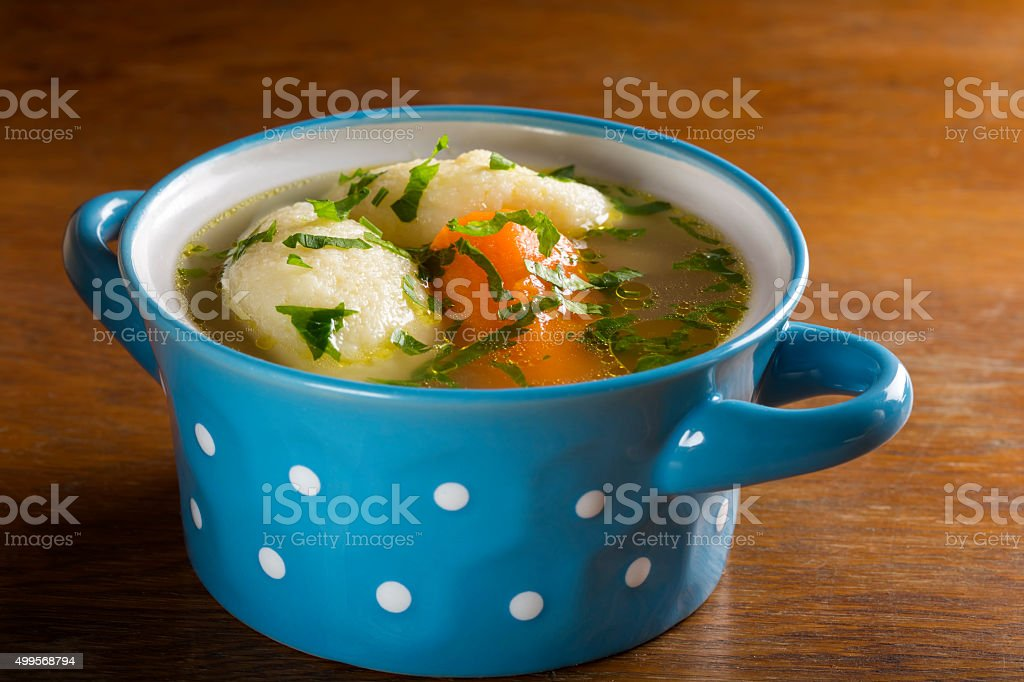 Chicken soup with dumplings stock photo