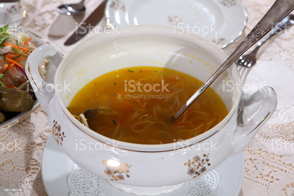 Chicken soup with homemade noodles stock photo