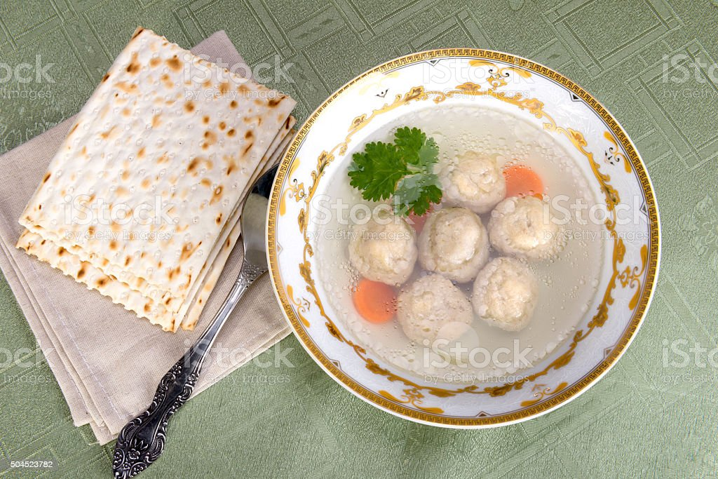 Chicken soup with Kneidlach (Matzah bolls) stock photo