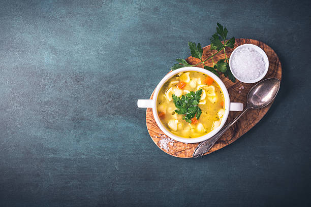 Chicken soup with noodles Chicken soup with noodles and parsley vegetable soup stock pictures, royalty-free photos & images