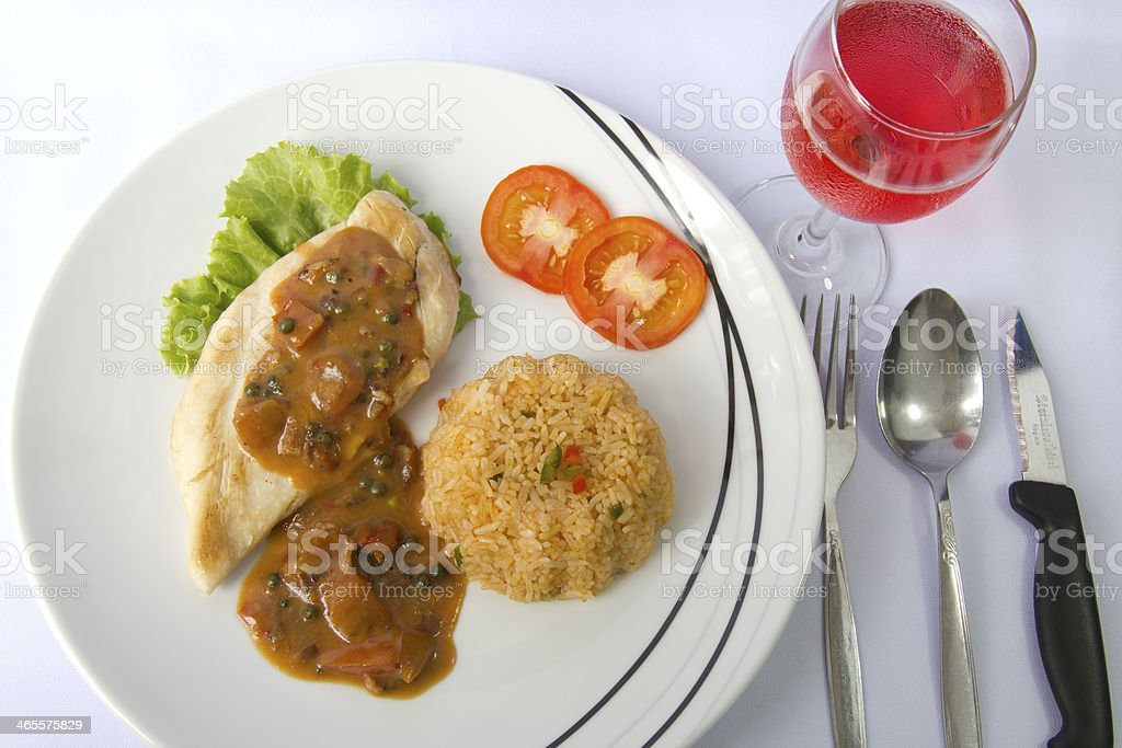 Chicken steak with fried rice and pink wine royalty-free stock photo