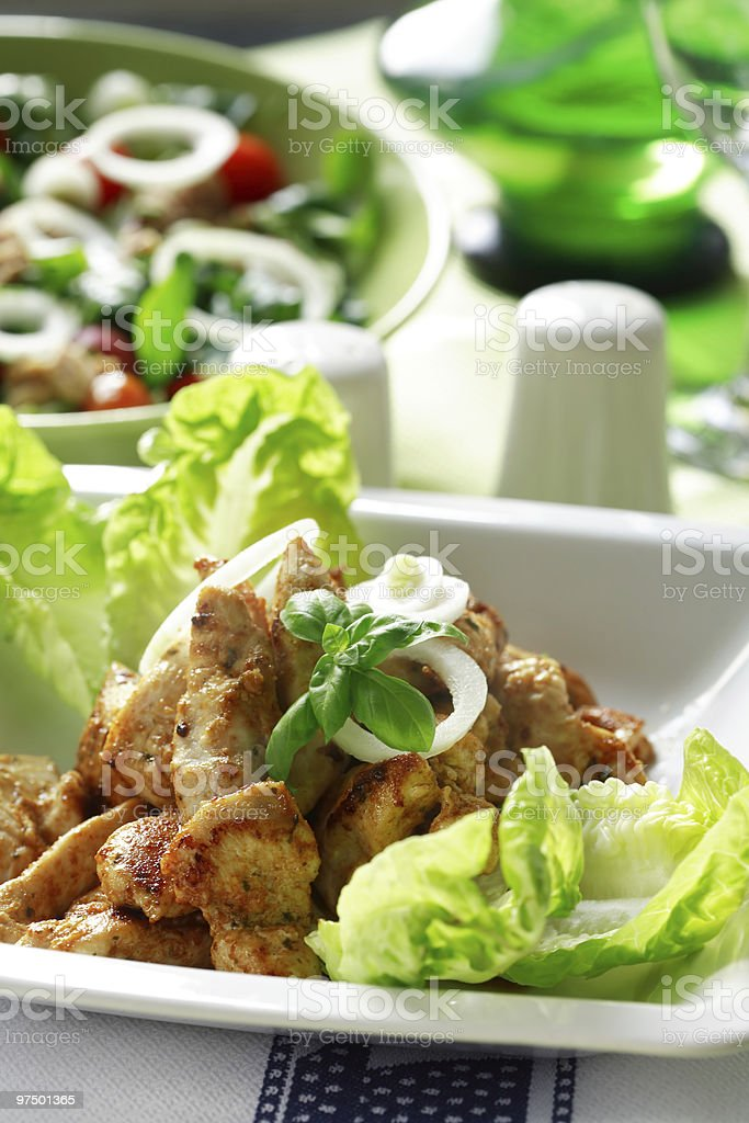 Chicken stripes with salad royalty-free stock photo