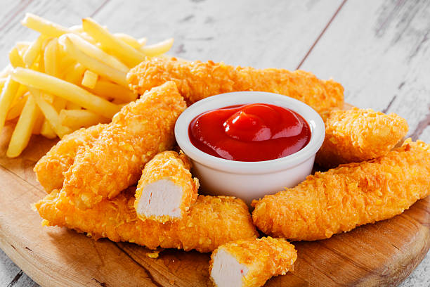 chicken stripsy stripsy chicken breaded with fries french chicken stock pictures, royalty-free photos & images