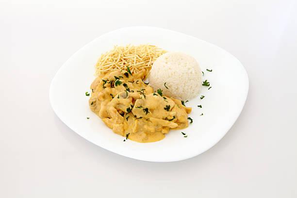 Chicken stroganoff on plate stock photo